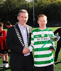 Ray Costello the captain of the Rehab Castlebar soccer team accecpts the cup from Cllr Ger Deere, Cathaoirleach of Castlebar Town Council...Pic Conor McKeown