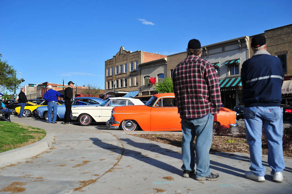 Visitors check out the Morning Maniacs Show and Shine car show on the square in downtown McKinney on Saturday, April 6, 2013. (Cooper Neill/The Dallas Morning News)