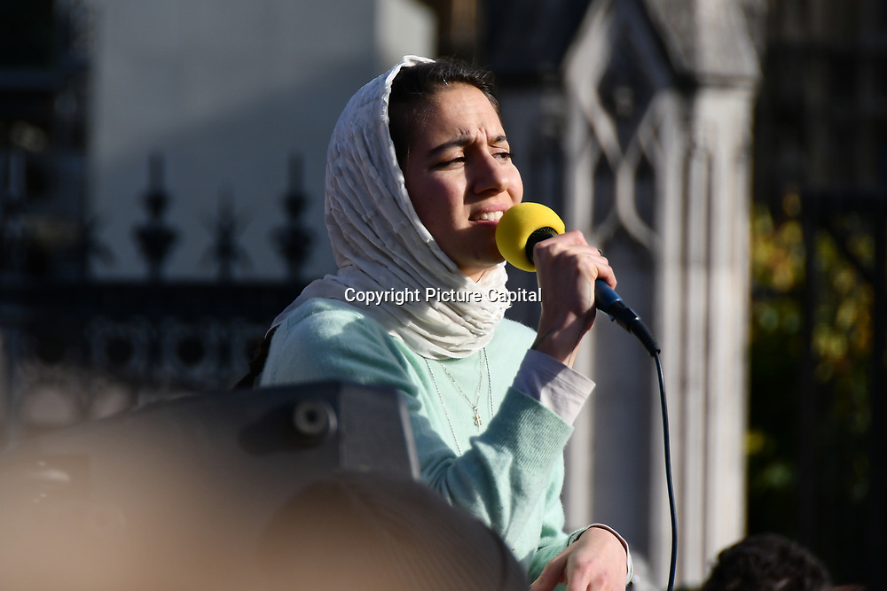 Speaker Zara Zaltash is an Iranian gives a power pray to Allah at the end calling everybody to kiss the floor sit-in outside Parliament of the Declaration of Rebellion on 31 October 2018,  London, UK