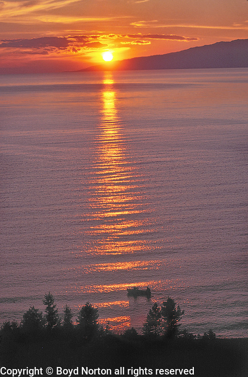 Barguzin Bay, sunset, Zabaikalski  National Park, Lake Baikal. Lake Baikal is the oldest (25 million years), deepest (5700 feet) and largest lake in the world by volume(it holds 20% of the earth's liquid fresh water). Threatened by pollution and most recently by an oil pipeline, Baikal has become a rallying point for Russian and international conservationists. Baikal was declared a World Heritage Site in 1996. Boyd Norton, the photographer here, worked with Russian and U.S. environmentalists to get Baikal designated a World Heritage Site.