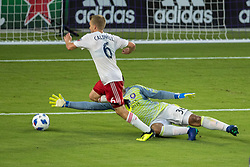 August 4, 2018 - Orlando, FL, U.S. - ORLANDO, FL - AUGUST 04: Orlando City goalkeeper Earl Edwards Jr (36) blocks a shot on goal from New England Revolution midfielder Scott Caldwell (6) during the soccer match between the Orlando City Lions and the New England Revolution on August 4, 2018 at Orlando City Stadium in Orlando FL. (Photo by Joe Petro/Icon Sportswire) (Credit Image: © Joe Petro/Icon SMI via ZUMA Press)