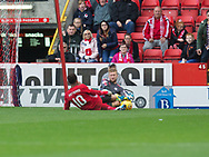 August 19th 2017, Pittodrie Stadium, Aberdeen, Scotland;  Scottish Premiership football, Aberdeen versus Dundee; Dundee goalkeeper Scott Bain in a painful challenge from Aberdeen's Nicky Maynard
