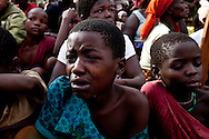 Relatives grieve for an education minister at a public funeral on May 18, 2010. The minister  was ambushed by the LRA and brutally murdered while traveling..