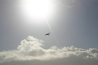 Small plane flying over Aran Islands