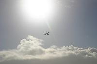 Small plane flying over Aran Islands