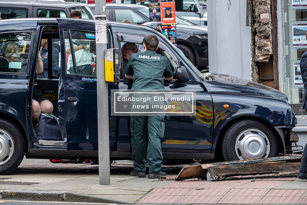 Pictured: <br /><br />A taxi crashed into the corner of North Castle Street and Queen street in Edinburgh knocking down a pedestrian.  According to eye-witnesses. the driver, Cameron Burt, appeared to have a black out and careered into the corner of Murray and Currie investements knocking down a man who was on the pavement.  Initial assesment by first aid helpers from Murray and Currie suggests that no life changing injuries had been  sustained. An amubalnce crew arrived within ten minutes of the accident.<br /><br />Ger Harley | EEm Date