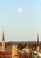 Middletown, NY - The full moon sets above the church steeples on Dec. 13, 2008. The December full moon was the largest of the year because the moon was the closest to earth. The moon was 14 percent bigger in our sky and 30 percent brighter than some other full moons during the year, according to NASA.