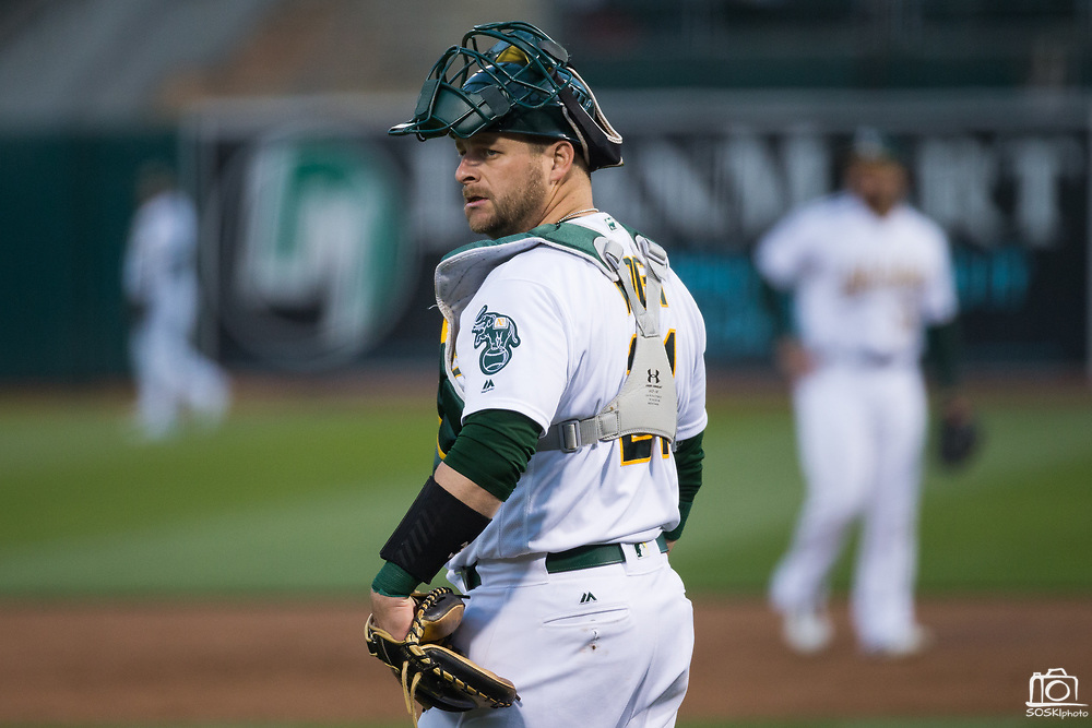 Oakland Athletics catcher Stephen Vogt (21) reacts to a Miami Marlins hit at Oakland Coliseum in Oakland, Calif., on May 23, 2017. (Stan Olszewski/Special to S.F. Examiner)