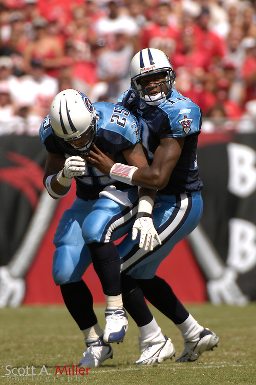 Oct. 14, 2007; Tampa, FL, USA; Tennessee Titans quarterback (10) Vince Young runs into running back (25) LenDale White as he was scrambling in the first half against the Tampa Bay Buccaneers at Raymond James Stadium. ...©2007 Scott A. Miller
