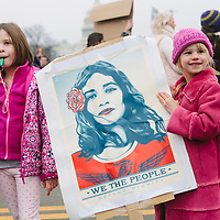 Rosie (right) 6 1/2 years old and Norah 6 years old (parents would not give their last names) hold a poster for the Women's March on Washington D.C., January 21, 2017