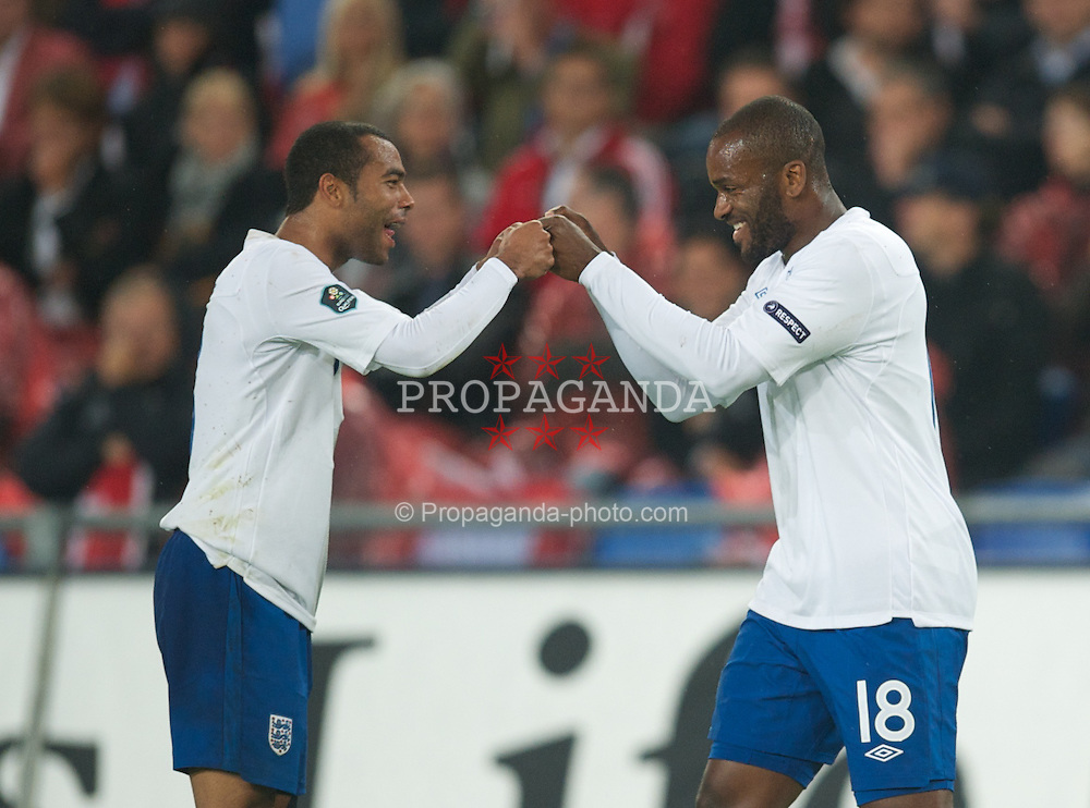BASEL, SWITZERLAND - Tuesday, September 7, 2010: England's Darren Bent celebrates scoring the third goal against Switzerland with team-mate Ashley Cole during the UEFA Euro 2012 Qualifying Group G match at St. Jakob-Park. (Pic by David Rawcliffe/Propaganda)