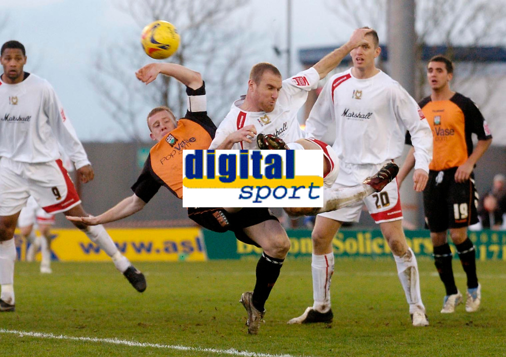 Photo: Leigh Quinnell.<br /> Milton Keynes Dons v Barnet. Coca Cola League 2. 20/01/2007. MK Dons Sean O'Hanlon is challenged in the area by Barnets Nicky Bailey.