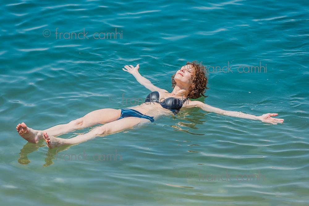 one woman swimming bathing in Dead Sea Jordan