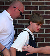 Jun 18, 2015 - Charleston, South Carolina, U.S. - <br /> <br /> Charleston Church Shooting<br /> <br /> Charleston shooting suspect DYLANN ROOF is escorted from the Shelby Police Dept. Thursday as the process begins to return him to South Carolina. Roof is suspected of fatally shooting nine people Wednesday night at the historic Emanuel African Methodist Episcopal Church in Charleston. <br /> ©Exclusivepix media