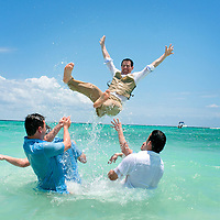 Dan and his groomsmen have fun in the Gulf of Mexico during their portrait session in Xpuha, Mexico.