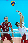 Poland's Fabian Drzyzga (right) setting the ball while volleyball final match between Brazil and Poland during the 2014 FIVB Volleyball World Championships at Spodek Hall in Katowice on September 21, 2014.<br /> <br /> Poland, Katowice, September 21, 2014<br /> <br /> For editorial use only. Any commercial or promotional use requires permission.<br /> <br /> Mandatory credit:<br /> Photo by &copy; Adam Nurkiewicz / Mediasport