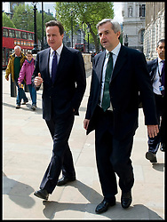 The Prime Minister David Cameron with Chris Huhne, the Secretary of State for Energy and Climate Change walking down Whitehall on their way to visit  DECC on May 14, 2010. Chris Huhne has quit as energy secretary, Friday February 3, 2012, after learning he was to be charged with perverting the course of justice over a 2003 speeding case Photo By Andrew Parsons/ i-Images