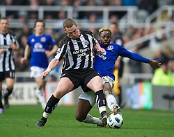 NEWCASTLE, ENGLAND - Saturday, March 5, 2011: Everton's Louis Saha and Newcastle United's captain Kevin Nolan during the Premiership match at St. James' Park. (Photo by David Rawcliffe/Propaganda)