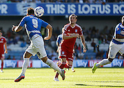 Charlie Austin heads it on in a dangerous position during the Sky Bet Championship match between Queens Park Rangers and Cardiff City at the Loftus Road Stadium, London, England on 15 August 2015. Photo by Andy Walter.