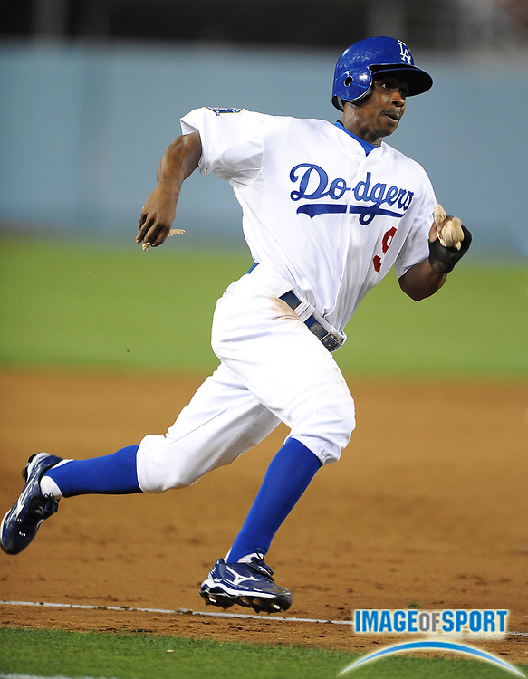 May 19, 2008; Los Angeles, CA, USA; Los Angeles Dodgers left fielder Juan Pierre (9) rounds third base during game against the Cincinnati Reds at Dodger Stadium.