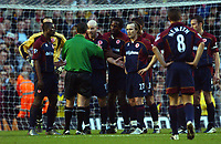 Referee Mr Andy D'Urso tries to calm down Danny Mills (Middlesbrough) Arsenal v Middlesbrough, Highbury, 10/01/2003, Premiership Football. Credit : Colorsport / Robin Hume. Digital File Only.