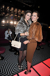 Left to right, AMBER LE BON and YASMIN LE BON at a party following the Issa fashion show at the February 2009 Fashion Week held at Raffles, King's Road, London on 23rd February 2009.