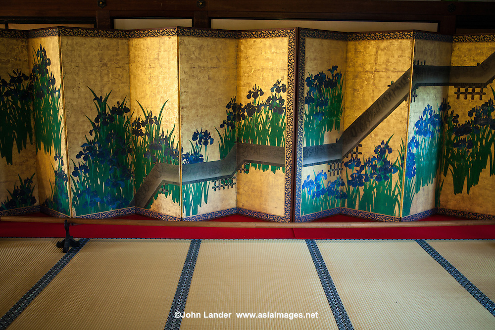 "Byobu, literally ""wind wall"" are Japanese folding screens made from several joined panels bearing decorative painting and calligraphy, used to separate interiors and enclose private spaces.  Other uses are as background for ikebana displays."