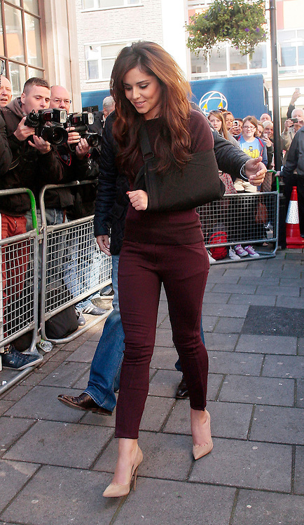 31.AUGUST.2012. LONDON<br /> <br /> CHERYL COLE ARRIVES AT BBC RADIO ONE FOR AN INTERVIEW WITH FEARNE COTTON WEARING A SLING<br /> <br /> BYLINE: EDBIMAGEARCHIVE.CO.UK<br /> <br /> *THIS IMAGE IS STRICTLY FOR UK NEWSPAPERS AND MAGAZINES ONLY*<br /> *FOR WORLD WIDE SALES AND WEB USE PLEASE CONTACT EDBIMAGEARCHIVE - 0208 954 5968*