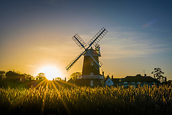 © Licensed to London News Pictures. 30/11/2018. Cley Next The Sea UK. The sun rises this morning behind Cley windmill in Cley Next The Sea on the Norfolk coast. Photo credit: Andrew McCaren/LNP