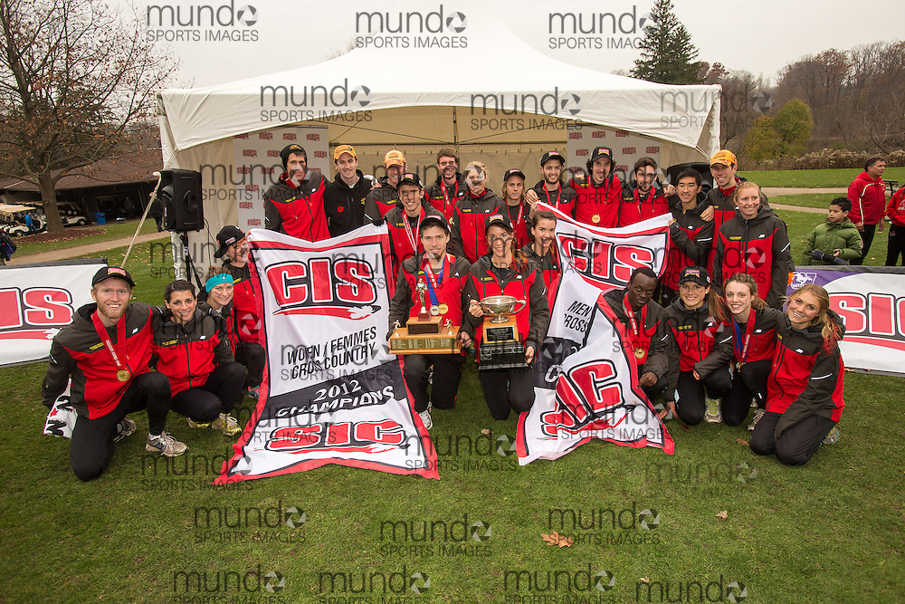 London, Ontario ---2012-11-10--- The Guelph Gryphons celebrate their sweep in the team competitions at the 2012 CIS Cross Country Championships at Thames Valley Golf Course in London, Ontario, November 10, 2012. .GEOFF ROBINS Mundo Sport Images