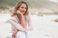 Woman sitting on beach portrait