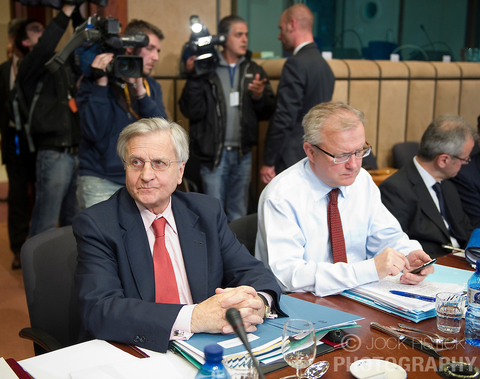Jean-Claude Trichet, president of the European Central Bank, left, and Olli Rehn, The EU's economic and monetary affairs commissioner, prepare for the meeting of European Union finance ministers in Brussels, Belgium, on Monday, May 17, 2010.  (Photo © Jock Fistick) .