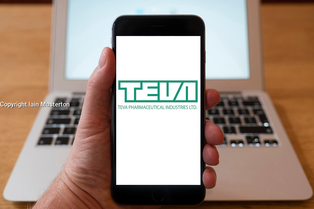 Using iPhone smartphone to display logo of Teva Pharmaceutical Industries Ltd; Israeli multinational pharmaceutical company