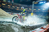 Stephen Foord of Calgary, AB, crosses the water crossing at Endurocross Las Vegas, NV.