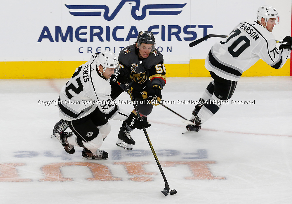 LAS VEGAS, NV - APRIL 11: Los Angeles Kings center Trevor Lewis (22) and Vegas Golden Knights left wing Erik Haula (56) battle for the puck during Game One of the Western Conference First Round of the 2018 NHL Stanley Cup Playoffs between the L.A. Kings and the Vegas Golden Knights Wednesday, April 11, 2018, at T-Mobile Arena in Las Vegas, Nevada. The Golden Knights won 1-0. (Photo by: Marc Sanchez/Icon Sportswire)
