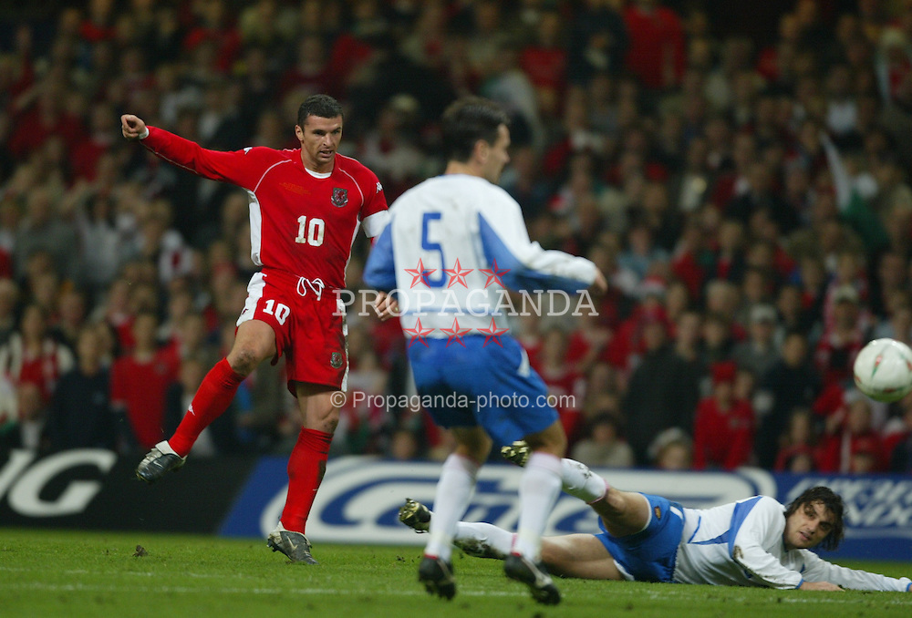 CARDIFF, WALES - Wednesday, November 19, 2003: Wales' Gary Speeds shoots at the Russian goal during the Euro 2004 Qualification Play Off match at the Millennium Stadium. (Pic by David Rawcliffe/Propaganda)