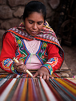 CUSCO, PERU - CIRCA SEPTEMBER 2019:  Portrait of a peruvian woman weaving in the region of the Sacred Valley in Peru/