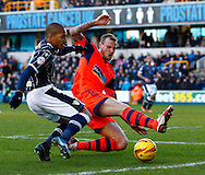 Simeon Jackson of Millwall and David Wheater of Bolton Wanderers during the Sky Bet Championship match at The Den, London<br /> Picture by David Horn/Focus Images Ltd +44 7545 970036<br /> 15/02/2014