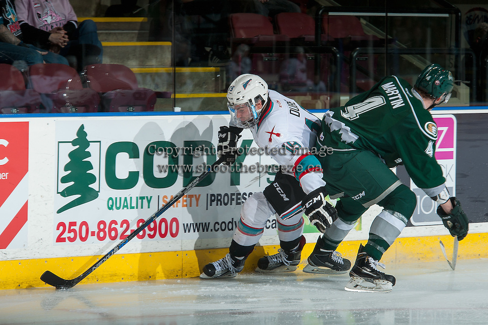 KELOWNA, CANADA - JANUARY 08: Brycen Martin #4 of Everett Silvertips checks Dillon Dube #19 of Kelowna Rockets as he skates with the puck during first period on January 8, 2016 at Prospera Place in Kelowna, British Columbia, Canada.  (Photo by Marissa Baecker/Shoot the Breeze)  *** Local Caption *** Dillon Dube; Brycen Martin;