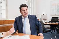 07 MAR 2019, BERLIN/GERMANY:<br /> Hubertus Heil, SPD, Bundesarbeitsminister, waehrend einem Interview, in seinem Buero, Bundesministerium fuer Arbeit und Soziales<br /> IMAGE: 20190307-01-014<br /> KEYWORDS: Büro