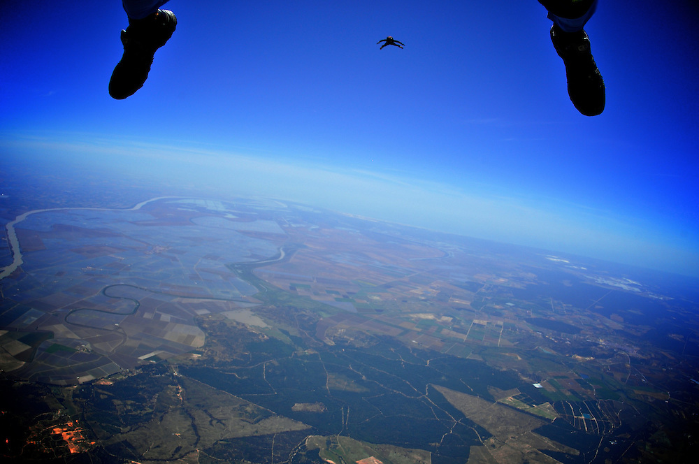 Skydiver Maxwell Hill On a Atmonauti pursuit during a coach dive in Skydive Spain.