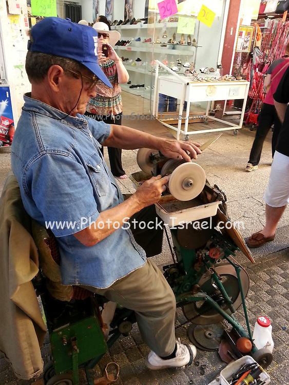 Street Knife sharpener Photographed in Haifa, Israel
