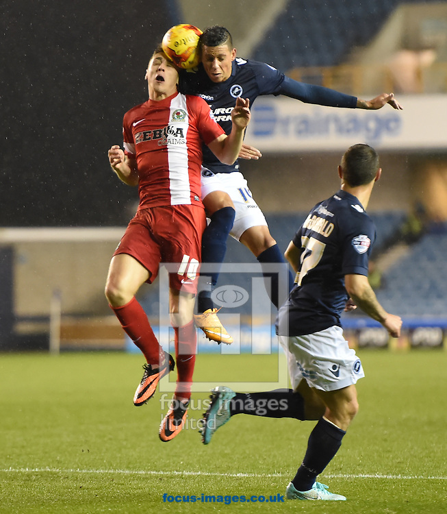Edward Upson of Millwall and Tom Cairney during the Sky Bet Championship match at The Den, London<br /> Picture by Alan Stanford/Focus Images Ltd +44 7915 056117<br /> 04/11/2014