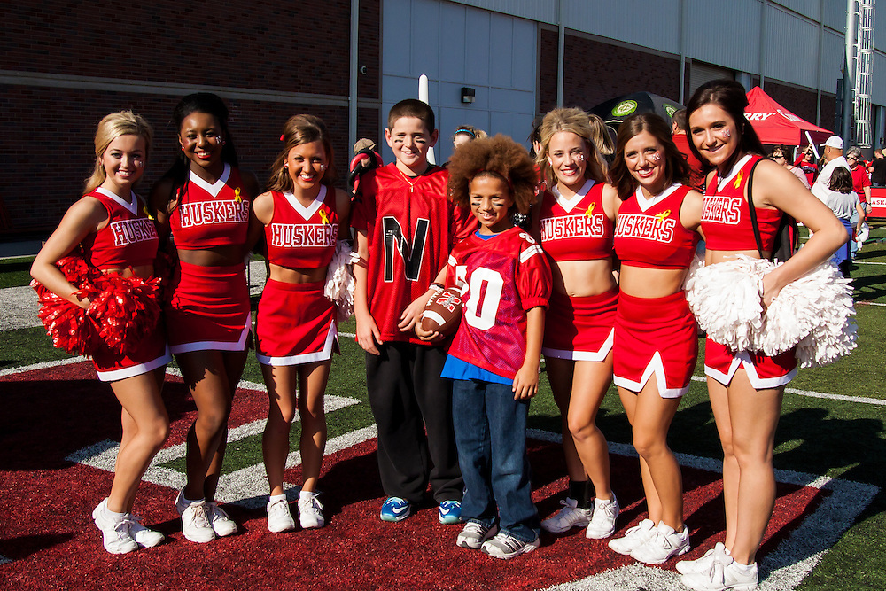"November 10, 2012: ""Little Kenny Bell"" and friend getting their picture taken with the Nebraska Cornhusker cheerleaders before the game against the Penn State Nittany Lions at Memorial Stadium in Lincoln, Nebraska. Nebraska defeated Penn State 32 to 23."