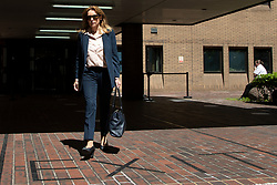 © Licensed to London News Pictures.30/07/2020. London, UK. Natalie Elphicke walks over an exit sign as she departs Southwark Crown court after her husband Charlie Elpicke was found guilty of three counts of sexual assault against two women.  Photo credit: George Cracknell Wright/LNP