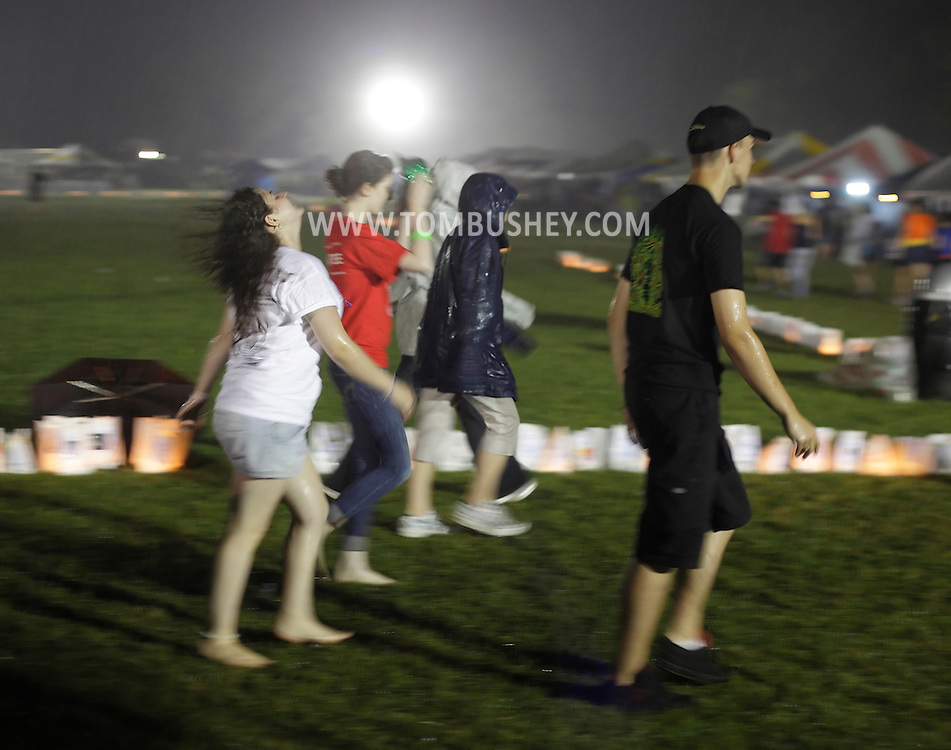 Pine Bush, New York - People from the Pine Bush community walk through the rain in the Relay for Life on Saturday, June 12, 2010.