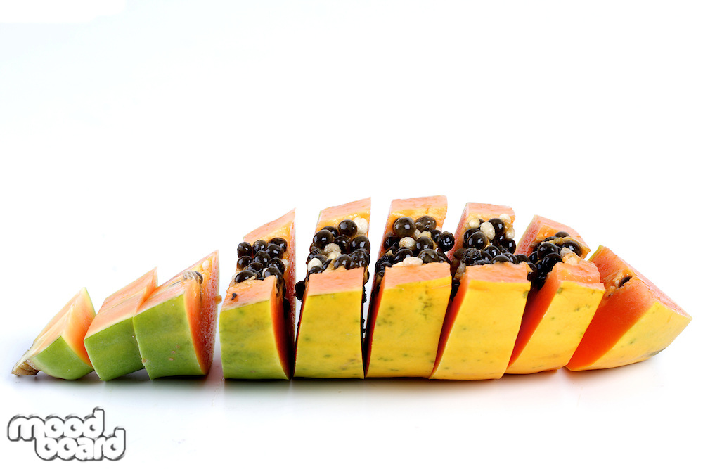 Slices of papaya on white background