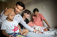 Ho Chi Minh 2016. Gabi Hollows with Tran Van Giap's family, wife Le Thi Binh and son Tran Binh Minh at Ho Chi Minh Hospital to welcome the arrival their newly born daughter Tran Thien Phuc.