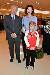 JASMINE GUINNESS with her father PATRICK GUINNESS and her son OTIS RAINEY at the launch of the 'Jasmine for Jaeger' fashion collection by Jasmine Guinness for fashion label Jaeger held at Fenwick's, Bond Street, London on 9th September 2015.