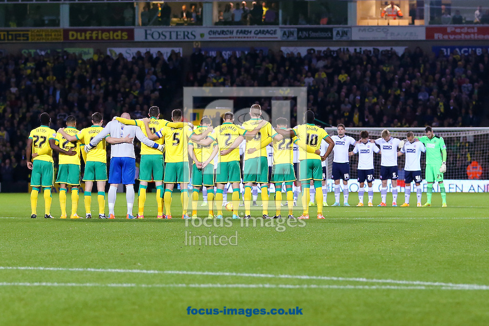 Players during a minutes silence to mark The Remembrance Service before the Sky Bet Championship match between Norwich City and Bolton Wanderers at Carrow Road, Norwich<br /> Picture by Richard Calver/Focus Images Ltd +447792 981244<br /> 31/10/2014